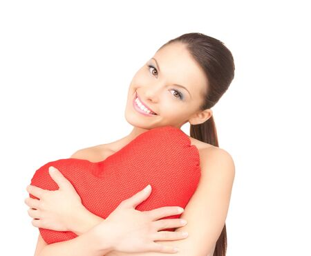 lovely woman with red heart-shaped pillow over white  photo