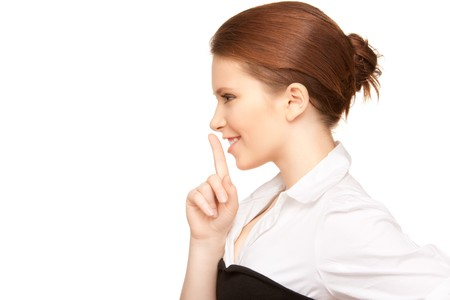 bright picture of teenage girl with finger on lips Stock Photo - 7366379