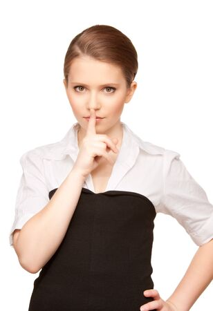 bright picture of teenage girl with finger on lips Stock Photo - 7366384