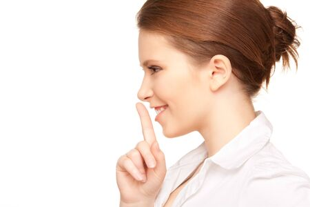 bright picture of teenage girl with finger on lips Stock Photo - 7366418