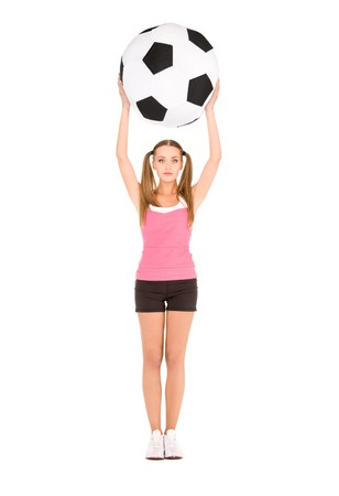 lovely woman with big soccer ball over white photo