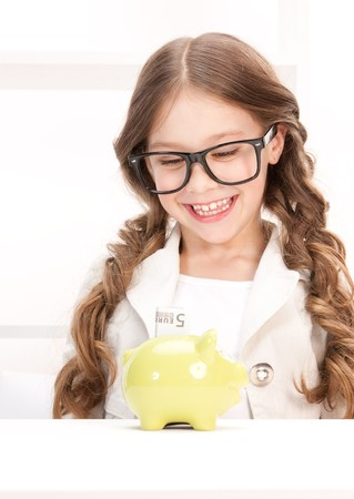 picture of little girl with piggy bank and money photo