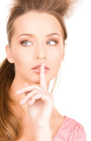 bright picture of young woman with finger on lips Stock Photo - 7366494