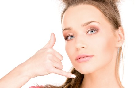 picture of lovely woman making a call me gesture Stock Photo - 7366372