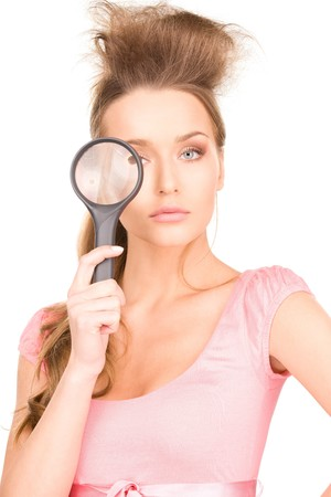 picture of lovely woman with magnifying glass photo