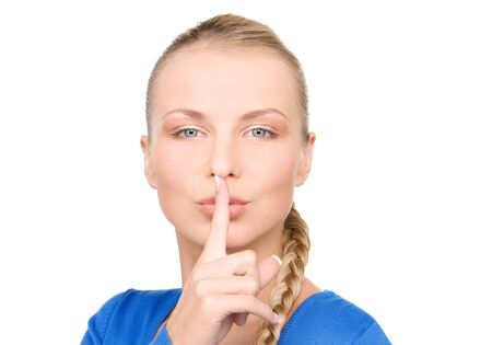 bright picture of teenage girl with finger on lips Stock Photo - 7366307