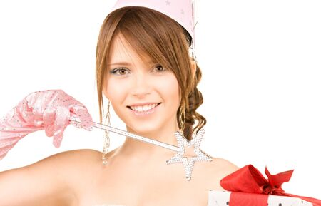 happy teenage party girl with magic wand and gift box photo
