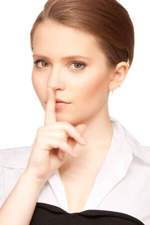 bright picture of teenage girl with finger on lips Stock Photo - 7366391
