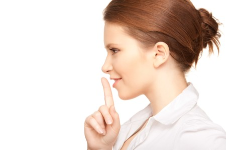 bright picture of teenage girl with finger on lips Stock Photo - 7366422