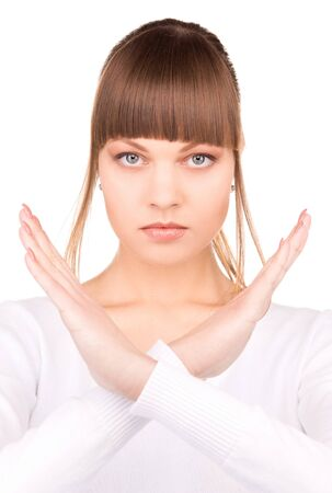 bright picture of young woman making stop gesture Stock Photo - 7366366