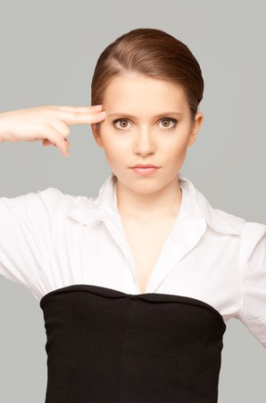 bright picture of unhappy woman showing suicide gesture Stock Photo - 7372704