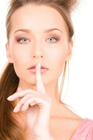 bright picture of young woman with finger on lips Stock Photo - 7372777
