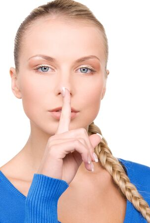 bright picture of teenage girl with finger on lips photo