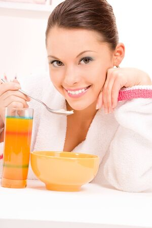 bright picture of woman eating her breakfast photo