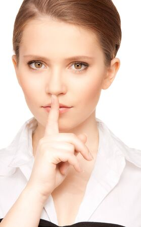 bright picture of teenage girl with finger on lips Stock Photo - 7372619