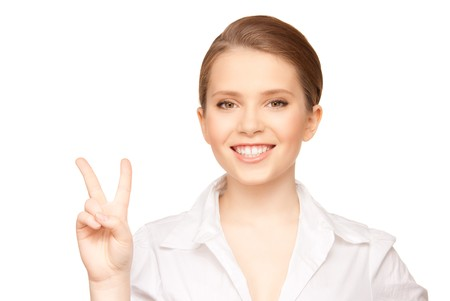 bright picture of lovely blonde showing victory sign  photo