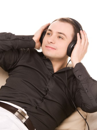 bright picture of happy man in headphones photo