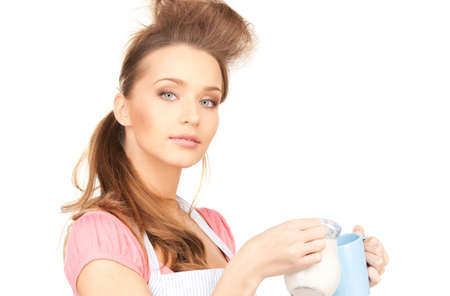picture of beautiful housewife with milk and mug photo