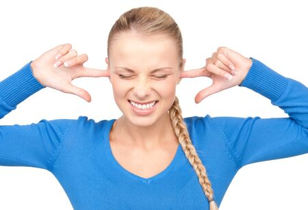 picture of smiling woman with fingers in ears Stock Photo - 7372796