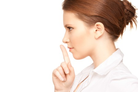 bright picture of teenage girl with finger on lips Stock Photo - 7372705