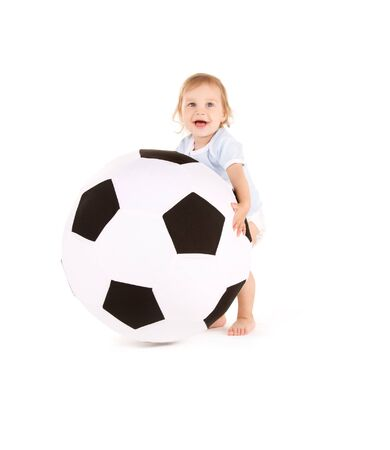 picture of baby boy with soccer ball over white photo