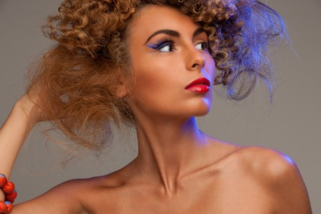 picture of lovely woman with fashionable hair over grey Stock Photo - 7418948