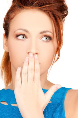 bright picture of teenage girl with hand over mouth Stock Photo - 7418915