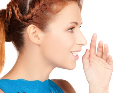 bright picture of teenage girl whispering gossip Stock Photo - 7418918