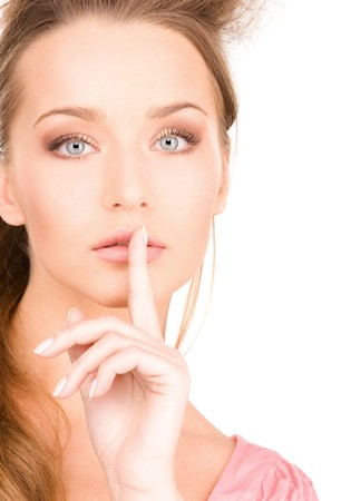 bright picture of young woman with finger on lips Stock Photo - 7418921