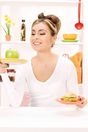 picture of woman with green apple and sandwich Stock Photo - 7418846