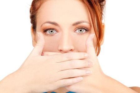 bright picture of teenage girl with hands over mouth Stock Photo - 7418753