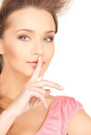 bright picture of young woman with finger on lips Stock Photo - 7418911