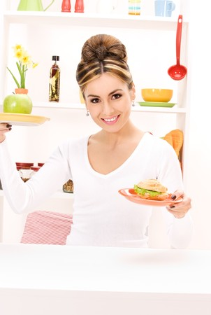 picture of woman with green apple and sandwich photo