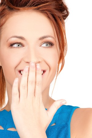 bright picture of teenage girl with hand over mouth Stock Photo - 7419095