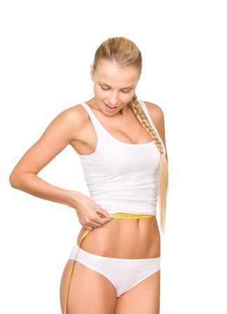 measure waist: young beautiful woman with measure tape over white Stock Photo