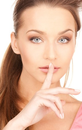 bright picture of young woman with finger on lips Stock Photo - 7419107
