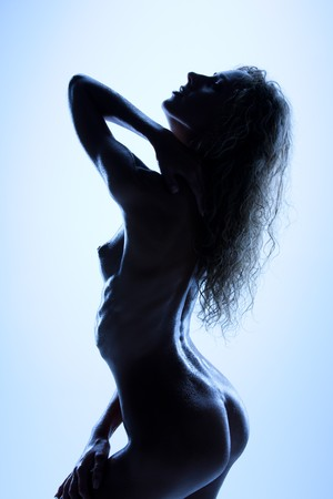 blue toned silhouette backlight picture of naked woman Stock Photo - 7437920