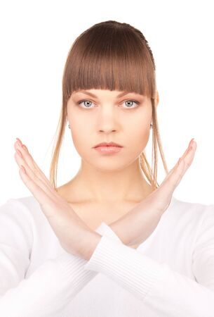 bright picture of young woman making stop gesture Stock Photo - 7437877