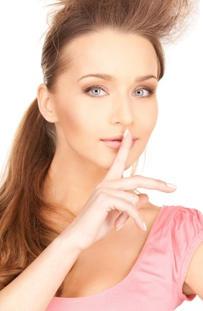 bright picture of young woman with finger on lips Stock Photo - 7438135