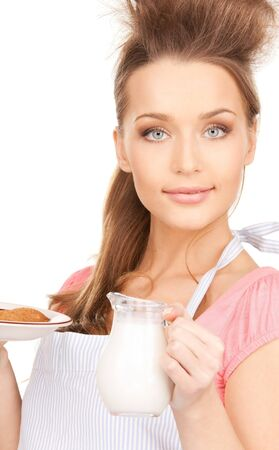 picture of beautiful housewife with milk and cookies photo