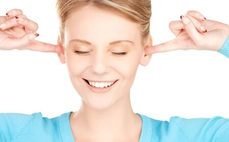 picture of smiling woman with hands over ears Stock Photo - 7438101