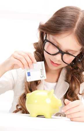picture of little girl with piggy bank and money Stock Photo - 7438263