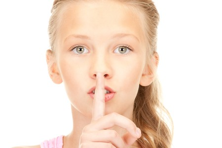 bright picture of pretty girl with finger on lips