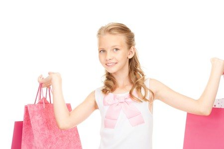 happy girl with shopping bags over white Stock Photo - 7438146