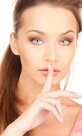 bright picture of young woman with finger on lips Stock Photo - 7438267