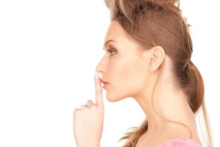 bright picture of young woman with finger on lips Stock Photo - 7438269
