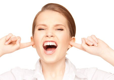 picture of woman with fingers in ears Stock Photo - 7438230
