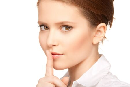 bright picture of teenage girl with finger on lips Stock Photo - 7521950
