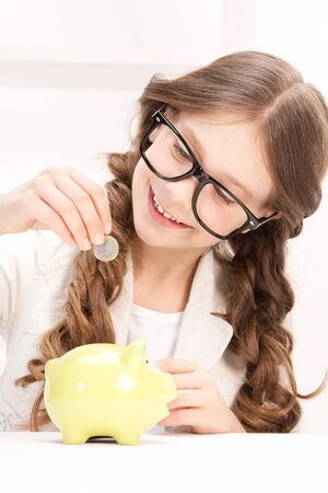 beautiful preteen girl: picture of little girl with piggy bank and coin