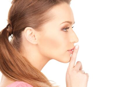 bright picture of young woman with finger on lips Stock Photo - 7521996